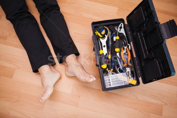 мастер на все руки босиком полу инструменты гостиной Сток-фото © wavebreak_media
