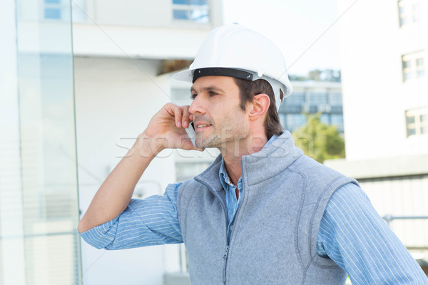 Architect using mobile phone outdoors Stock photo © wavebreak_media