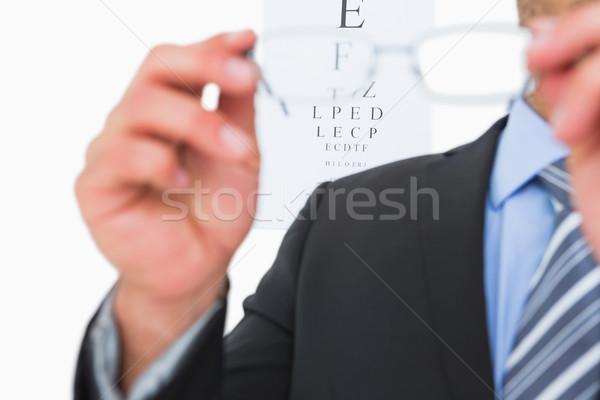 Biznesmen okulary okulary w górę przeczytać Zdjęcia stock © wavebreak_media