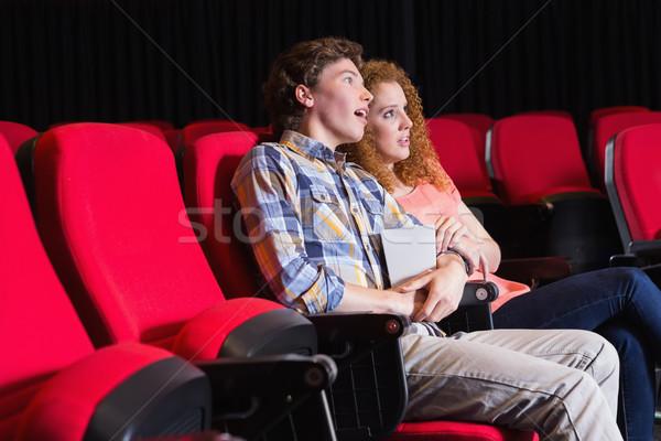 Fiatal pér néz film mozi nő étel Stock fotó © wavebreak_media