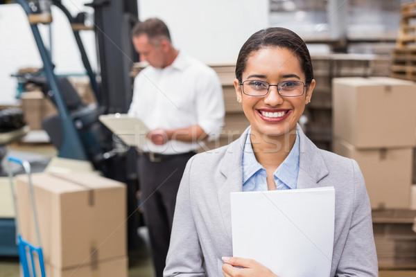 Female manager holding files during busy period Stock photo © wavebreak_media