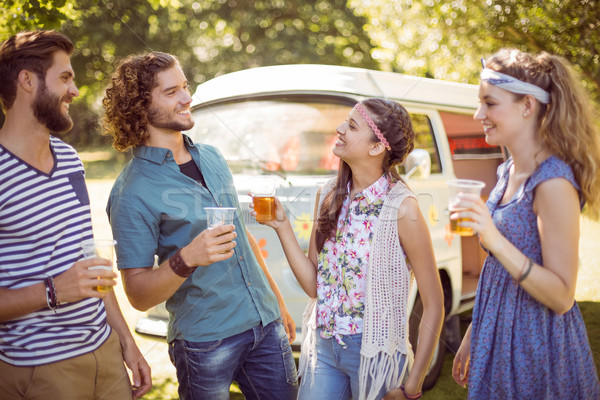 Hipster friends having a beer together Stock photo © wavebreak_media