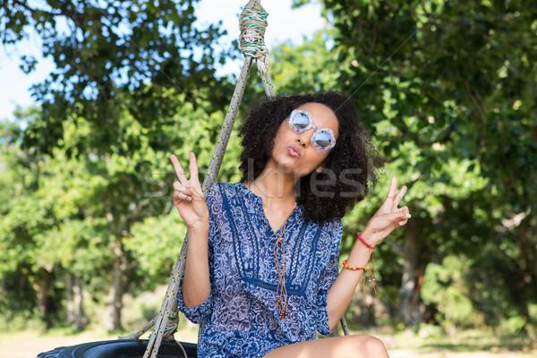 Joli jeune femme pneu Swing heureux nature Photo stock © wavebreak_media