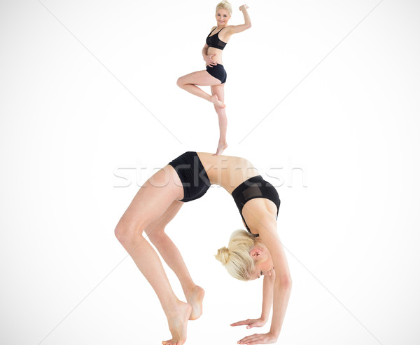 Composite image of side view of a fit young woman doing the whee Stock photo © wavebreak_media