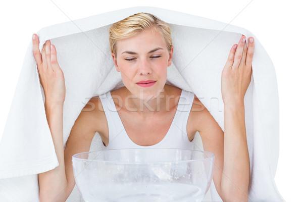 Blonde woman inhaling herbal medicine  Stock photo © wavebreak_media