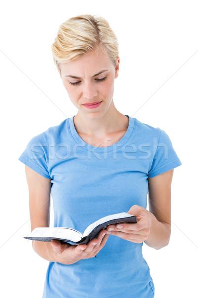 Blonde woman reading bible Stock photo © wavebreak_media