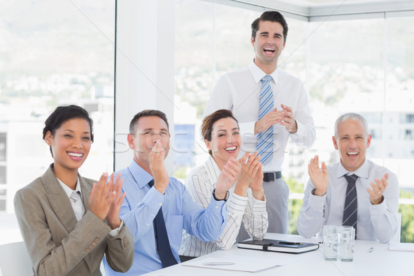 Stock photo: Business team applauding during conference