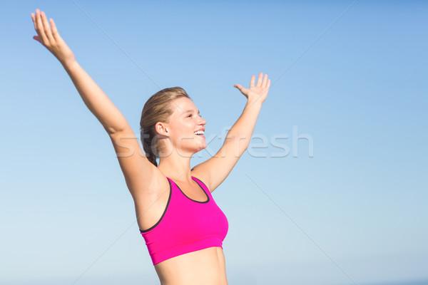 Dragen mooie geschikt vrouw juichen Stockfoto © wavebreak_media