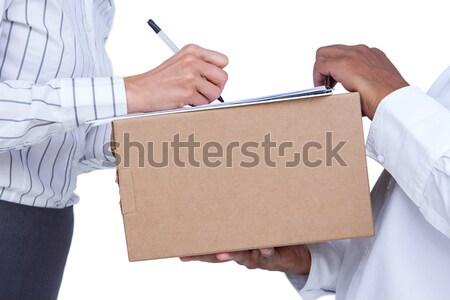 Mujer de negocios firma documentos paquete blanco mujer Foto stock © wavebreak_media