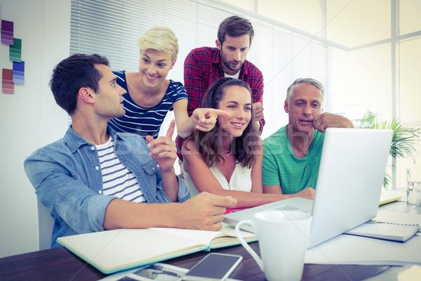 Kreatív üzleti csapat laptopot használ megbeszélés boldog iroda Stock fotó © wavebreak_media