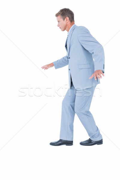 Unsmiling businessman in suit walking Stock photo © wavebreak_media