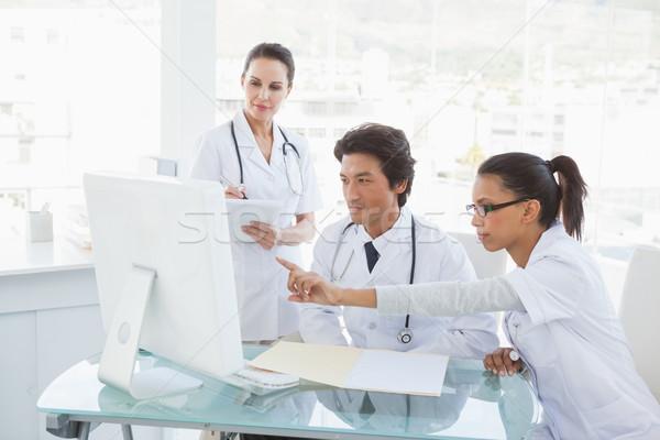 Doctors looking at the computer monitor Stock photo © wavebreak_media