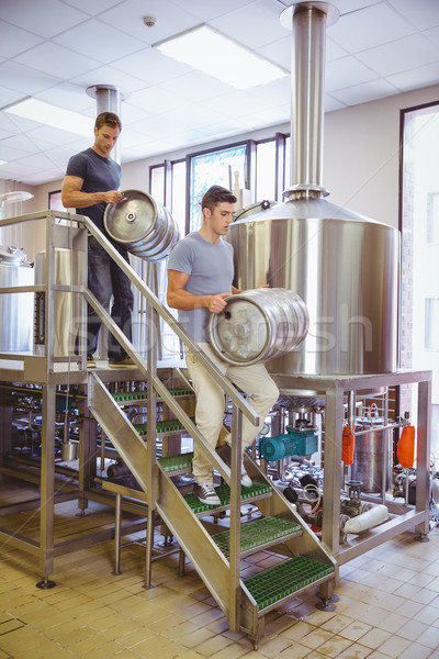 Young men carrying keg smiling at camera Stock photo © wavebreak_media