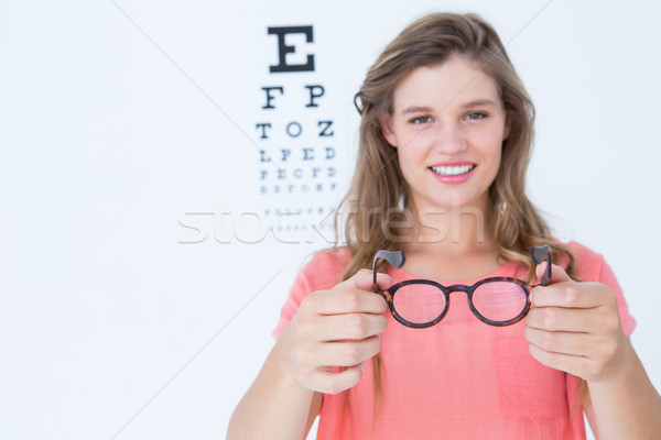 Hipster showing glasses next to an eye test Stock photo © wavebreak_media