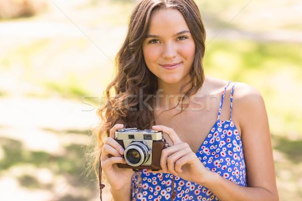 Pretty brunette in the park using retro camera Stock photo © wavebreak_media