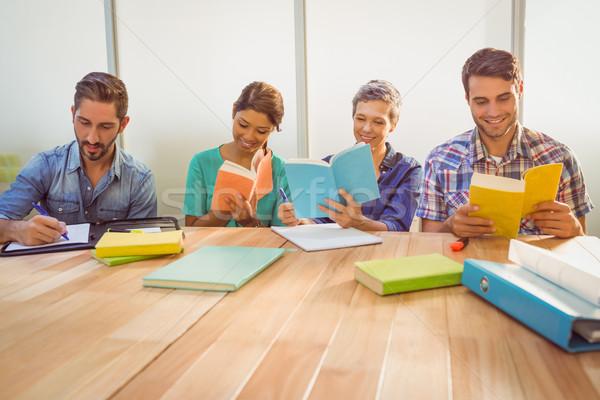 Group of colleagues reading books Stock photo © wavebreak_media