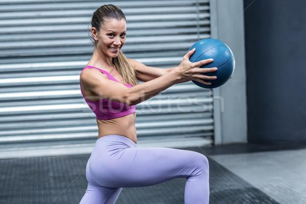A muscular woman doing ball exercises Stock photo © wavebreak_media