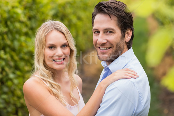 Young happy couple smiling at camera Stock photo © wavebreak_media