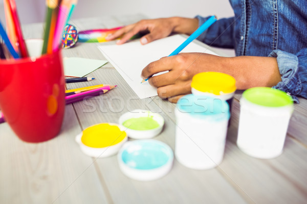 Graphic designer drawing on sheet of paper Stock photo © wavebreak_media