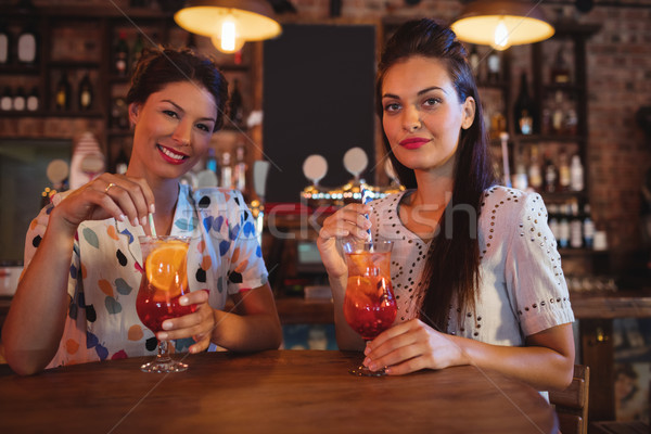 Portrait of two young women having cocktail drinks Stock photo © wavebreak_media