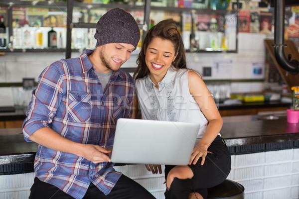 Happy friends using laptop in restaurant Stock photo © wavebreak_media