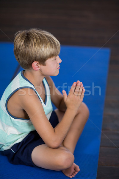 Boy performing yoga at home Stock photo © wavebreak_media
