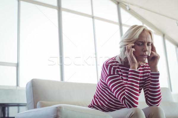 сидят диван служба женщину очки Сток-фото © wavebreak_media