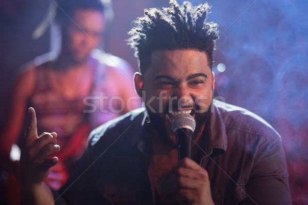 Young singer performing on stage at nightclub Stock photo © wavebreak_media