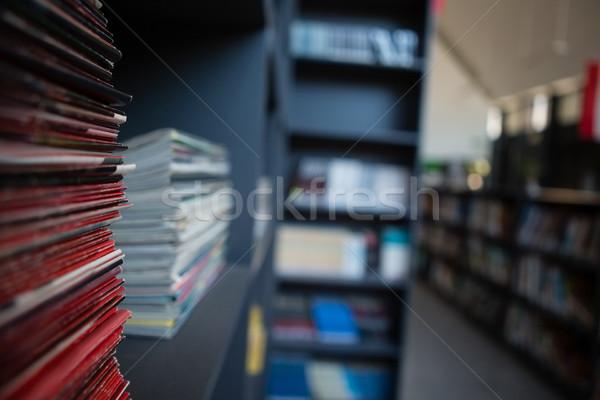 Stack of books on shelf in library Stock photo © wavebreak_media