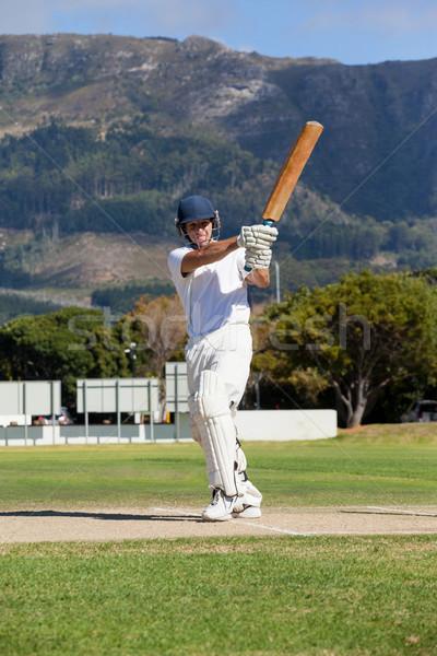 Full length of batsman playing cricket on field Stock photo © wavebreak_media