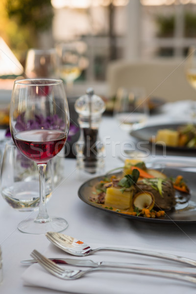 Red wine with food served on table Stock photo © wavebreak_media