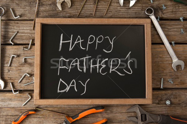 Slate with happy fathers day text amidst hand tools on table Stock photo © wavebreak_media
