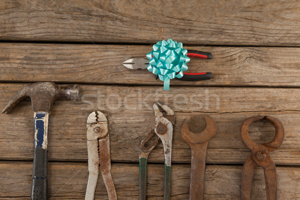 Pliers with ribbon by hand tools on table Stock photo © wavebreak_media