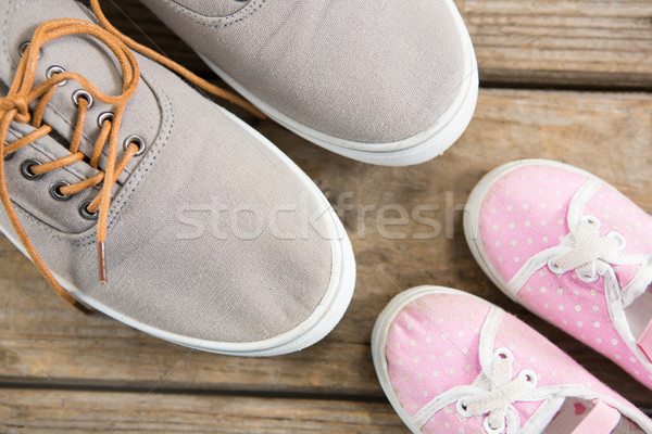 Pink and brown shoes on wooden floor Stock photo © wavebreak_media