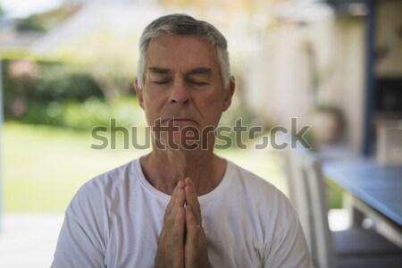 Senior man meditating at porch Stock photo © wavebreak_media