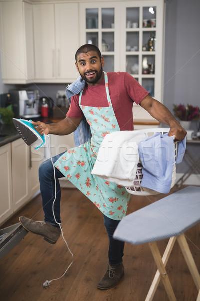 портрет счастливым человека корзина для белья железной Сток-фото © wavebreak_media