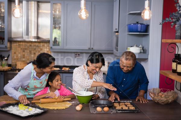 Happy multi-generation family preparing cookies in kitchen Stock photo © wavebreak_media