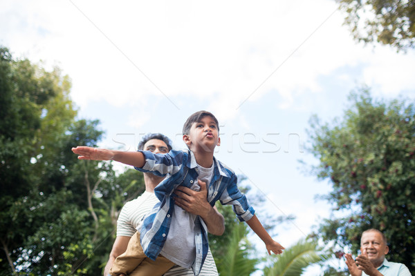 Low angle view of man looking at father playing with son Stock photo © wavebreak_media