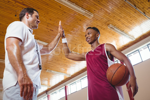 Low angle view of basketball player high fiving with coach Stock photo © wavebreak_media