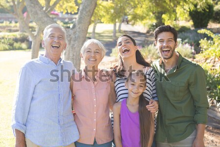 Cheerful seniors standing while looking at each other Stock photo © wavebreak_media