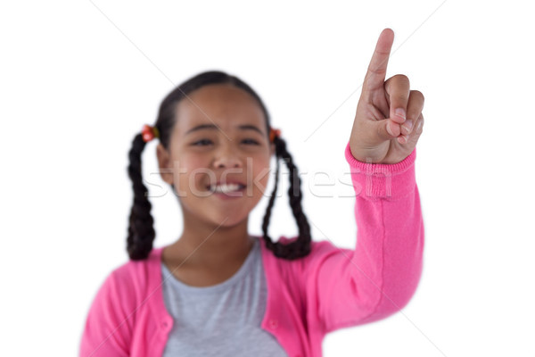 Girl pressing an invisible virtual screen Stock photo © wavebreak_media