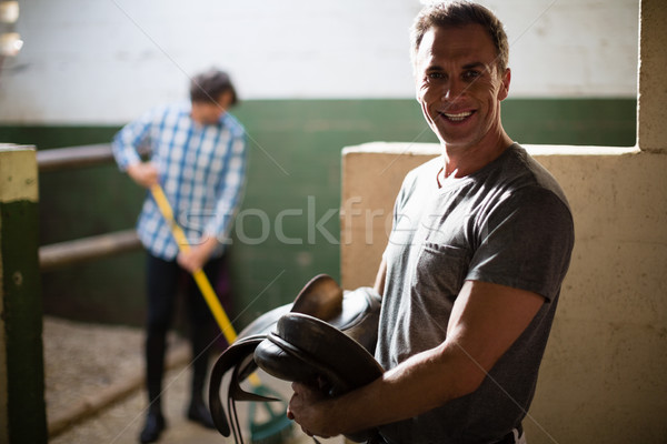 Man working in the stable Stock photo © wavebreak_media