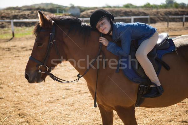 Cute girl embracing horse in the ranch Stock photo © wavebreak_media