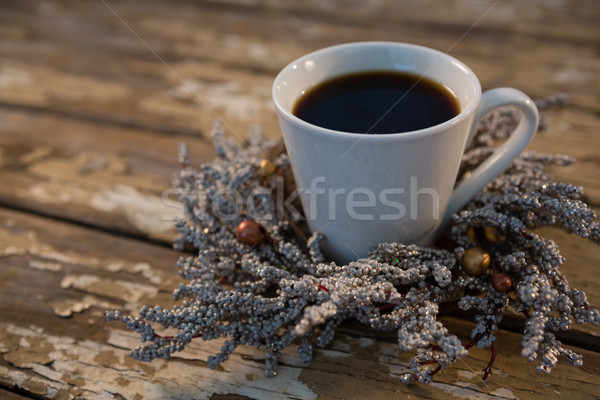 Close up of black coffee on dried plant at wooden table Stock photo © wavebreak_media