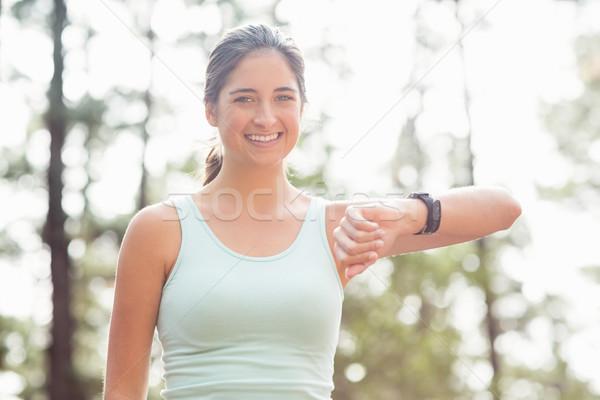 Happy jogger looking camera Stock photo © wavebreak_media