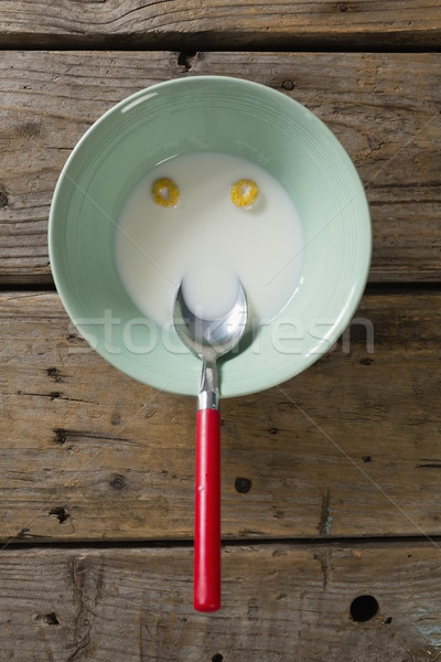 Cereal anéis rosto sorridente tigela leite mesa de madeira Foto stock © wavebreak_media
