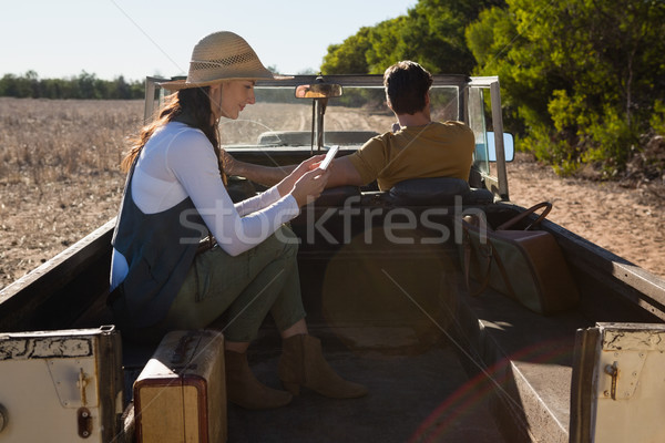 Woman using phone with man driving off road vehicle Stock photo © wavebreak_media