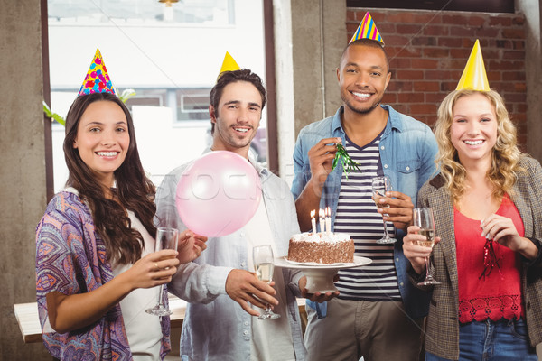 Portrait of casual business people celebrating birthday in offic Stock photo © wavebreak_media