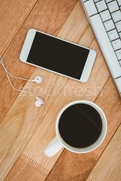 Black smartphone with cup of coffee Stock photo © wavebreak_media