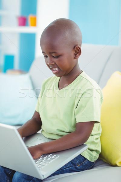 Dizüstü bilgisayar kullanıyorsanız kanepe bilgisayar çocuk teknoloji Stok fotoğraf © wavebreak_media